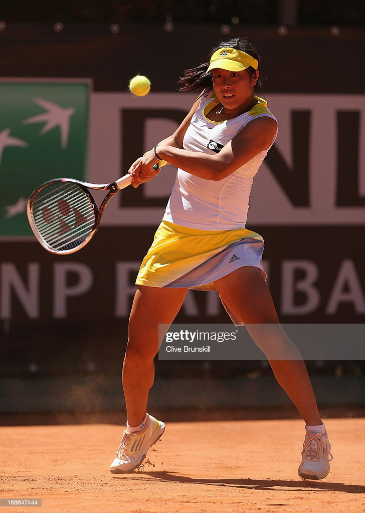 <a gi-track='captionPersonalityLinkClicked' href=/galleries/search?phrase=Ayumi+Morita&family=editorial&specificpeople=569402 ng-click='$event.stopPropagation()'>Ayumi Morita</a> of Japan plays a backhand against Sorana Cirstea of Romania in their first round match during day two of the Internazionali BNL d'Italia 2013 at the Foro Italico Tennis Centre on May 13, 2013 in Rome, Italy.