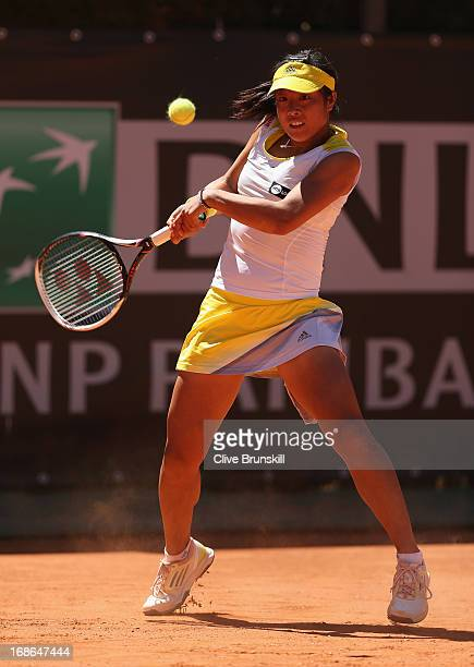 Ayumi Morita of Japan plays a backhand against Sorana Cirstea of Romania in their first round match during day two of the Internazionali BNL d'Italia...