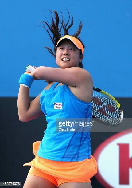 Ayumi Morita of Japan plays a backhand in her first round match against Nadiya Kichenok of the Ukraine during day two of the 2014 Australian Open at...