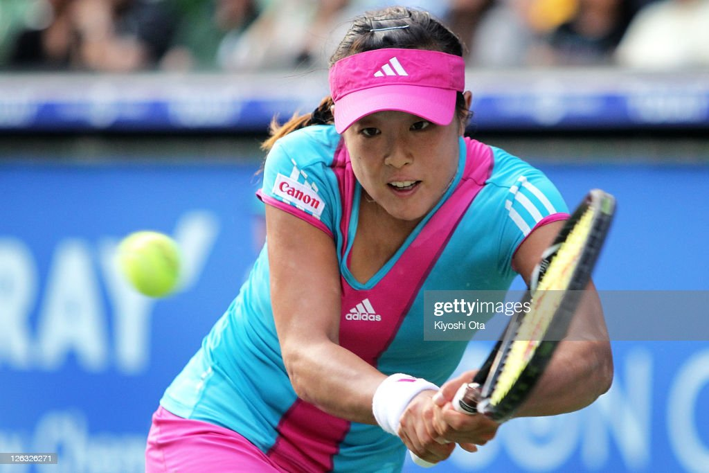 <a gi-track='captionPersonalityLinkClicked' href=/galleries/search?phrase=Ayumi+Morita&family=editorial&specificpeople=569402 ng-click='$event.stopPropagation()'>Ayumi Morita</a> of Japan plays a backhand in her match against Irina Falconi of the United States during the day one of the Toray Pan Pacific Open at Ariake Colosseum on September 25, 2011 in Tokyo, Japan.