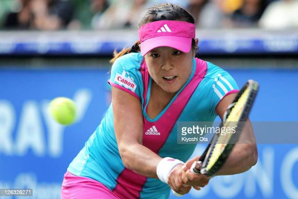 Ayumi Morita of Japan plays a backhand in her match against Irina Falconi of the United States during the day one of the Toray Pan Pacific Open at...