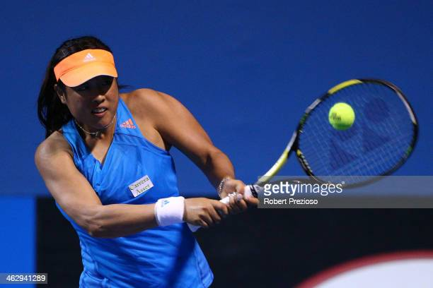 Ayumi Morita of Japan plays a backhand in her second round match against Jelena Jankovic of Serbia during day four of the 2014 Australian Open at...