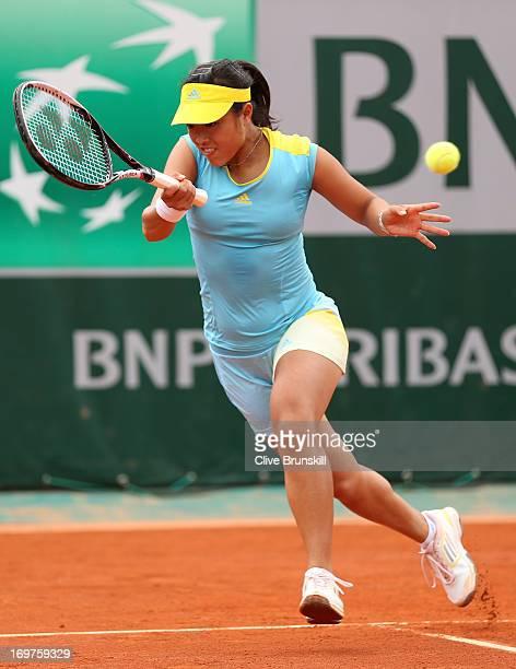 Ayumi Morita of Japan plays a forehand during the Women's Doubles match between Sorana Cirstea of Romania and Ayumi Morita of Japan and Andrea...