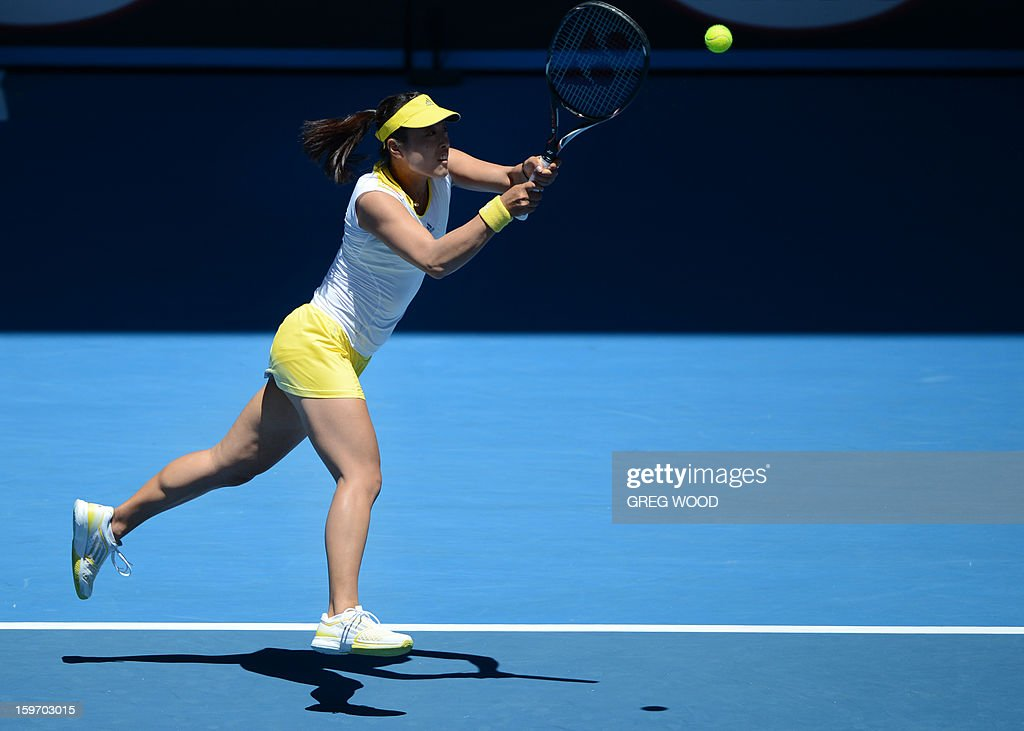 Ayumi Morita of Japan plays a return during her women's singles match against Serena Williams of the US on the sixth day of the Australian Open tennis tournament in Melbourne on January 19, 2013. AFP PHOTO/ GREG WOOD IMAGE STRICTLY RESTRICTED TO EDITORIAL USE - STRICTLY NO COMMERCIAL USE