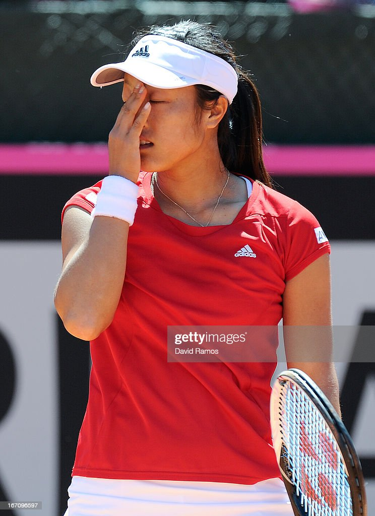 <a gi-track='captionPersonalityLinkClicked' href=/galleries/search?phrase=Ayumi+Morita&family=editorial&specificpeople=569402 ng-click='$event.stopPropagation()'>Ayumi Morita</a> of Japan reacts after missing a point against Silvia Soler of Spain during the Fed Cup World Group Play off at the Real Club de Polo of Barcelona on April 20, 2013 in Barcelona, Spain.