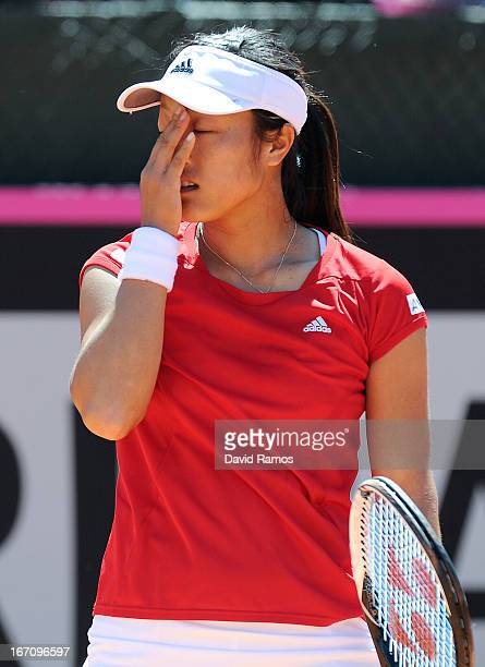 Ayumi Morita of Japan reacts after missing a point against Silvia Soler of Spain during the Fed Cup World Group Play off at the Real Club de Polo of...