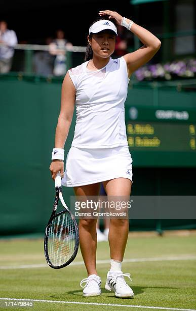 Ayumi Morita of Japan reacts during her Ladies' Singles first round match against Marina Erakovic of New Zealand on day two of the Wimbledon Lawn...