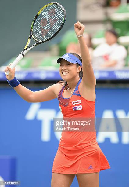 Ayumi Morita of Japan reacts during her women's singles first round match against Laura Robson of Great Britain during day two of the Toray Pan...