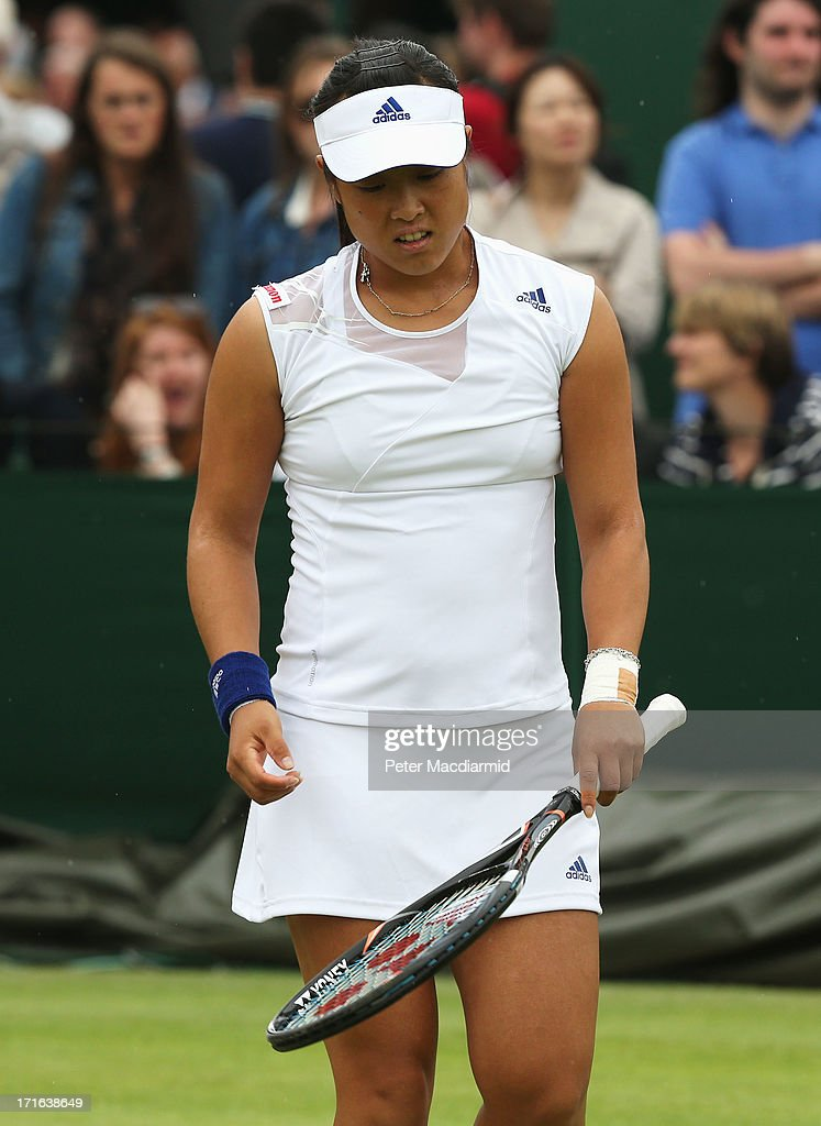 <a gi-track='captionPersonalityLinkClicked' href=/galleries/search?phrase=Ayumi+Morita&family=editorial&specificpeople=569402 ng-click='$event.stopPropagation()'>Ayumi Morita</a> of Japan reacts during the Ladies' Doubles first round match between Sorana Cirstea of Romania and <a gi-track='captionPersonalityLinkClicked' href=/galleries/search?phrase=Ayumi+Morita&family=editorial&specificpeople=569402 ng-click='$event.stopPropagation()'>Ayumi Morita</a> of Japan and Kirsten Flipkens of Belgium and Magdalena Rybarikova of Slovakia on day four of the Wimbledon Lawn Tennis Championships at the All England Lawn Tennis and Croquet Club on June 27, 2013 in London, England.