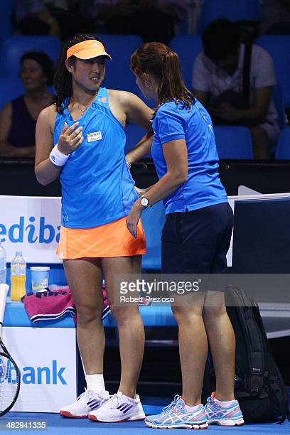 Ayumi Morita of Japan receives medical treatment in her second round match against Jelena Jankovic of Serbia during day four of the 2014 Australian...