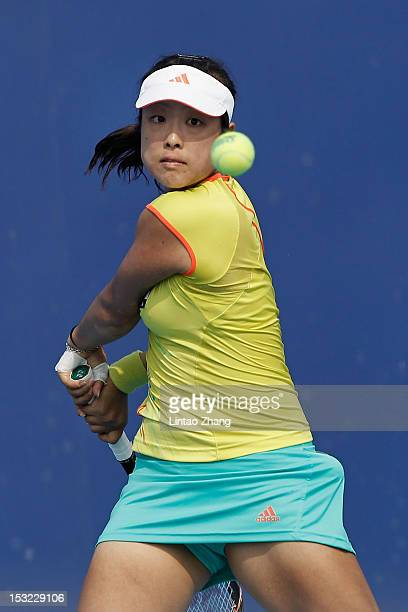 Ayumi Morita of Japan returns a shot to Marion Bartoli of France during the Day 4 of China Open at the China National Tennis Center on October 2 2012...