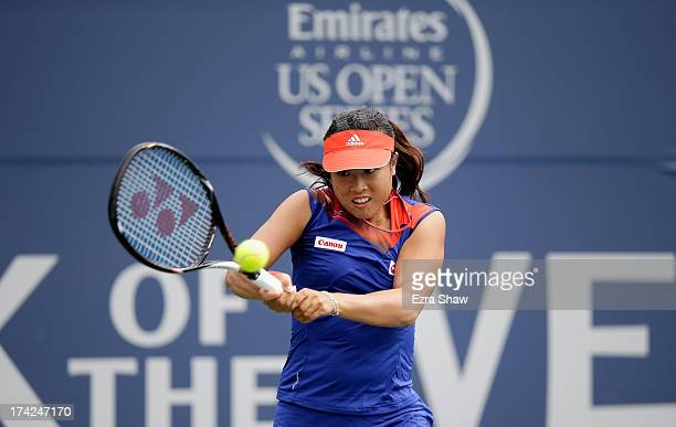 Ayumi Morita of Japan returns a shot to Sorana Cirstea of Romania during their match on Day 1 of the Bank of the West Classic at Stanford University...