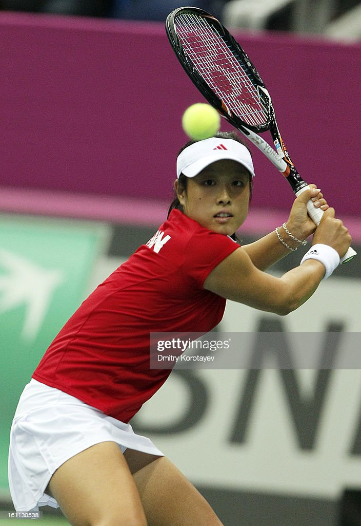 Ayumi Morita of Japan returns the ball against Ekaterina Makarova of Russia during day one of the Federation Cup 2013 World Group Quarterfinal match between Russia and Japan at Olympic Stadium on February 09, 2013 in Moscow, Russia.