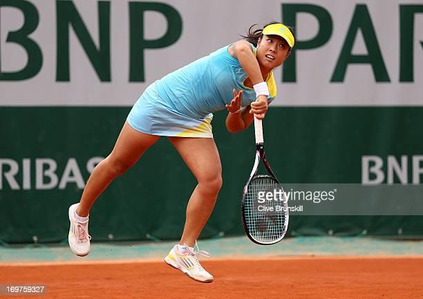 Ayumi Morita of Japan serves during the Women's Doubles match between Sorana Cirstea of Romania and Ayumi Morita of Japan and Andrea Hlavackova of...