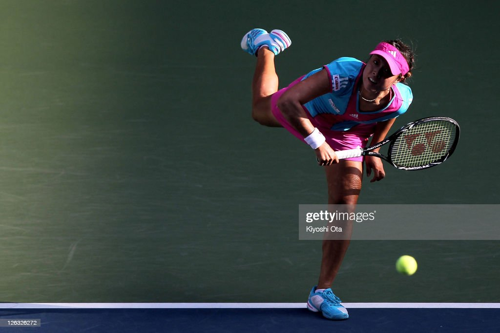 <a gi-track='captionPersonalityLinkClicked' href=/galleries/search?phrase=Ayumi+Morita&family=editorial&specificpeople=569402 ng-click='$event.stopPropagation()'>Ayumi Morita</a> of Japan serves in her match against Irina Falconi of the United States during the day one of the Toray Pan Pacific Open at Ariake Colosseum on September 25, 2011 in Tokyo, Japan.