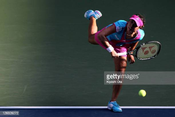Ayumi Morita of Japan serves in her match against Irina Falconi of the United States during the day one of the Toray Pan Pacific Open at Ariake...