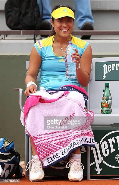Ayumi Morita of Japan smiles during a break in the Women's Doubles match between Sorana Cirstea of Romania and Ayumi Morita of Japan and Andrea...