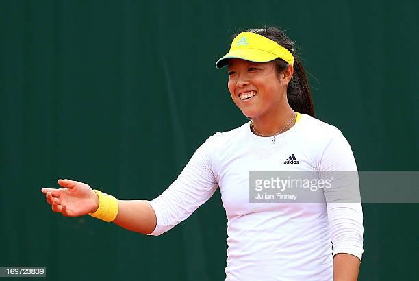 Ayumi Morita of Japan smiles during the Women's Doubles match between Simona Halep of Romania and Arantxa Rus of Netherlands and Sorana Cirstea of...