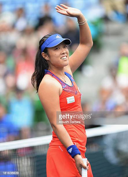Ayumi Morita of Japan waves during her women's singles first round match against Laura Robson of Great Britain during day two of the Toray Pan...