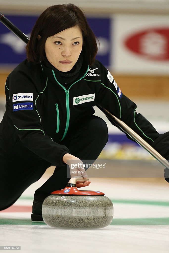 Ayumi Ogasawara of Hokkaido Bank throws a stone during the last day of qualifier for the Curling Japan Qualifying Tournament at Dohgin Curling Stadium on September 14, 2013 in Sapporo, Japan.