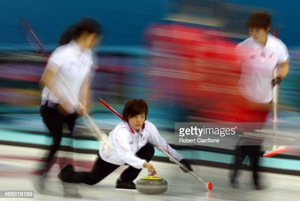 Ayumi Ogasawara of Japan delivers the stone during the Curling Women's Round Robin match between Japan and Great Britain on day seven of the Sochi...
