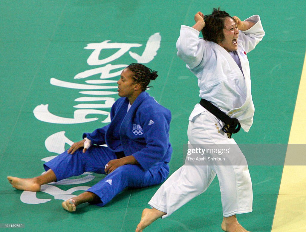 <a gi-track='captionPersonalityLinkClicked' href=/galleries/search?phrase=Ayumi+Tanimoto&family=editorial&specificpeople=2258318 ng-click='$event.stopPropagation()'>Ayumi Tanimoto</a> (white) of Japan celebrates winning the gold medal after beating <a gi-track='captionPersonalityLinkClicked' href=/galleries/search?phrase=Lucie+Decosse&family=editorial&specificpeople=609740 ng-click='$event.stopPropagation()'>Lucie Decosse</a> (blue) of France in the women's Judo -63kg gold medal match at the Beijing Science and Technology University Gymnasium on day four of the Beijing 2008 Olympic Games on August 12, 2008 in Beijing, China.