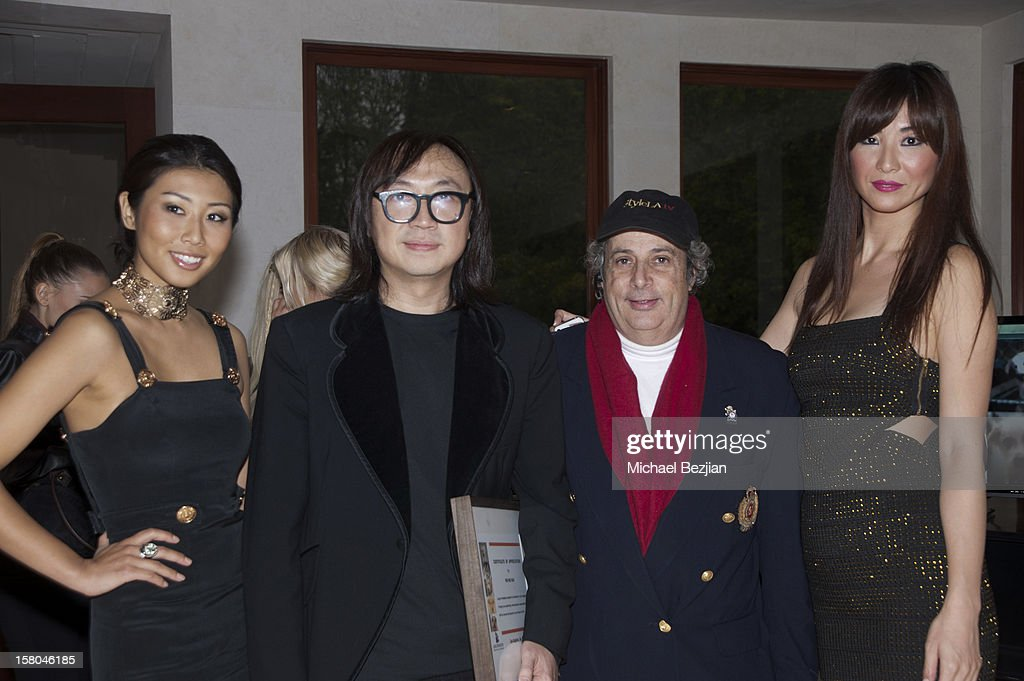 Ayumi, Wayne Kao, Robert King and Mayuko pose for portrait at 'Posing Heroes' BeautyAnd Portrait Day Benefiting The Lange Foundation on December 2, 2012 in Holmby Hills, California.