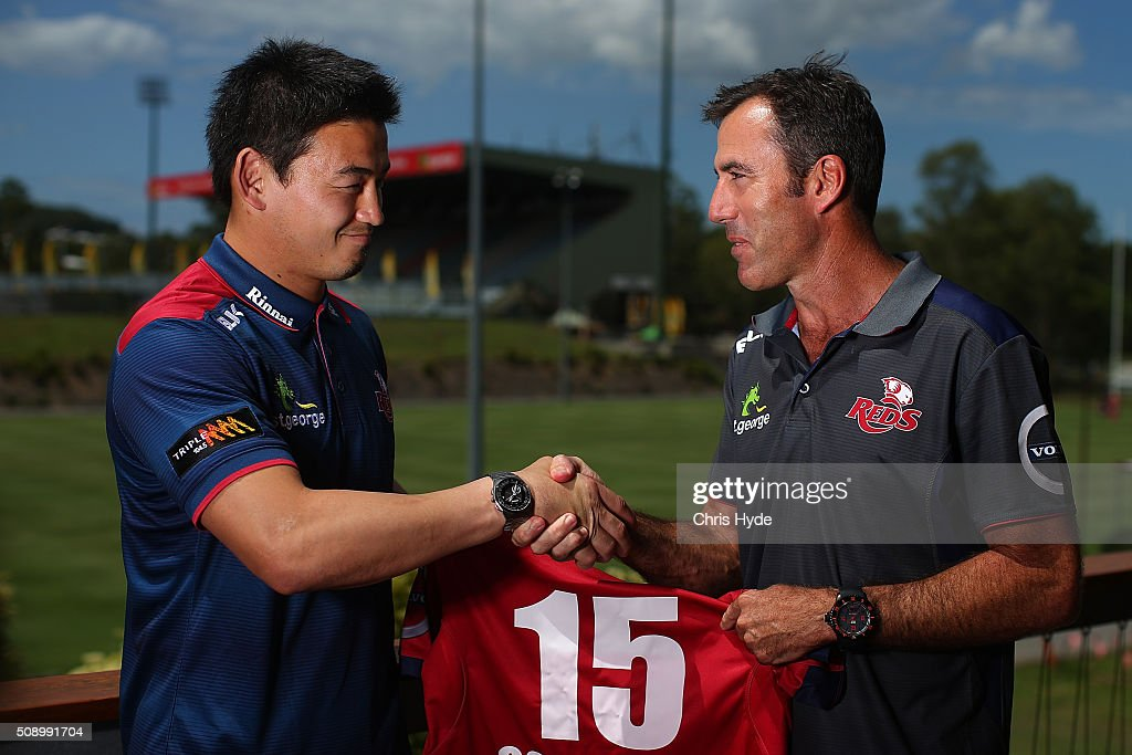 Ayumu Goromaru and Head Coach Richard Graham shake hands during a Reds Super Rugby media opportunity at Ballymore Stadium on February 8, 2016 in Brisbane, Australia.