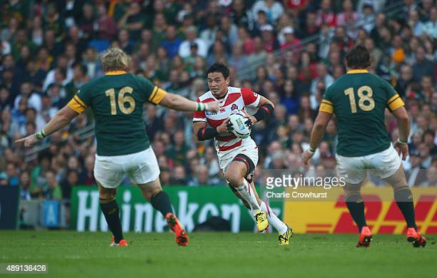 Ayumu Goromaru of Japan attacks the South African defence during the 2015 Rugby World Cup Pool B match between South Africa and Japan at the Brighton...