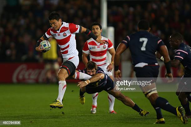 Ayumu Goromaru of Japan breaks with the ball during the 2015 Rugby World Cup Pool B match between USA and Japan at Kingsholm Stadium on October 11...