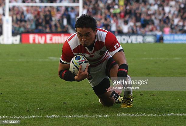 Ayumu Goromaru of Japan dives over the score his team's second try during the 2015 Rugby World Cup Pool B match between South Africa and Japan at the...