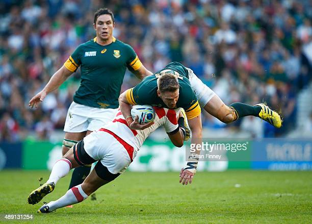 Ayumu Goromaru of Japan tackles Jean De Villiers of South Africa during the 2015 Rugby World Cup Pool B match between South Africa and Japan at the...