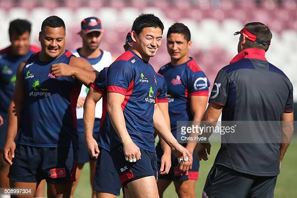 Ayumu Goromaru talks to players and staff during a Queensland Reds Super Rugby training session at Ballymore Stadium on February 8 2016 in Brisbane...