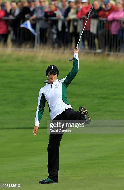 Azahara Munoz of Europe reacts to a putt on the 16th green during the morning foursomes on day one of the 2011 Solheim Cup at Killeen Castle Golf...