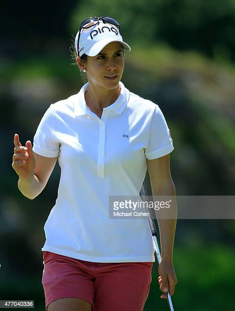 Azahara Munoz of Spain acknowledges the gallery on the sixth green during the third round of the KPMG Women's PGA Championship held at Westchester...