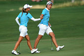 Azahara Munoz of Spain and Carlota Ciganda of Spain and the European Team walk off the 16th green as they went on to win their match over Gerina...