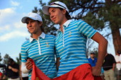 Azahara Munoz of Spain and Carlota Ciganda of Spain and the European Team look on after winning their match by one hole over Gerina Piller and Angela...