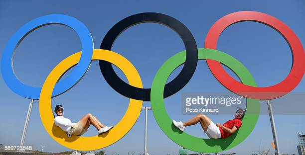 Azahara Munoz of Spain and Carlota Ciganda of Spain posr in the Olympic rings during a practice round prior to the Women's Individual Stroke Play...