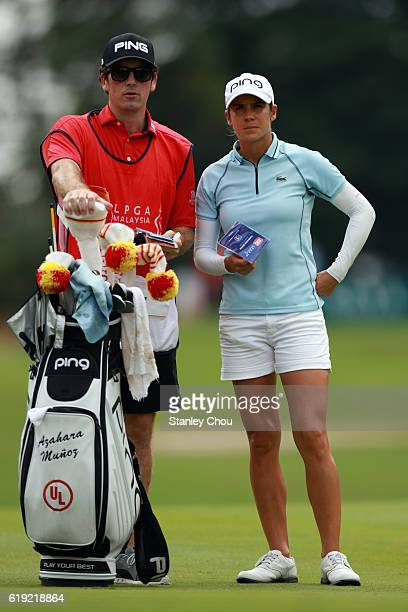 Azahara Munoz of Spain and her caddie waits on the 9th hole during day four of the Sime Darby LPGA at TPC Kuala Lumpur on October 30 2016 in Kuala...