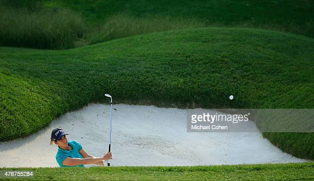 Azahara Munoz of Spain hits her third shot from a bunker on the seventh hole during the first round of the KPMG Women's PGA Championship held at...