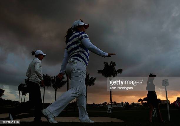 Azahara Munoz of Spain Inbee Park of South Korea and Paula Creamer wals off the 15th hole after play was suspended due to darkness during round two...