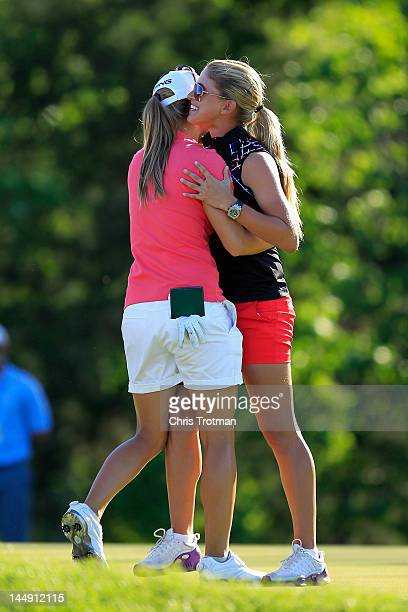 Azahara Munoz of Spain is congratulated by LPGA golfer Belen Mozo of Spain after defeating Candie Kung of Taiwan in the championship match at the...