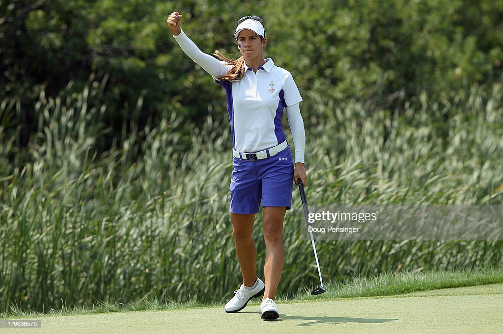 <a gi-track='captionPersonalityLinkClicked' href=/galleries/search?phrase=Azahara+Munoz&family=editorial&specificpeople=2259549 ng-click='$event.stopPropagation()'>Azahara Munoz</a> of Spain playing for the European Team celebrates as she sinks a putt on the 17th hole to clinch victory with her teammate Karine Icher of France over Cristie Kerr and Paula Creamer of the United States during the Friday morning foursomes matches at the 2013 Solheim Cup on August 16, 2013 at the Colorado Golf Club in Parker, Colorado.