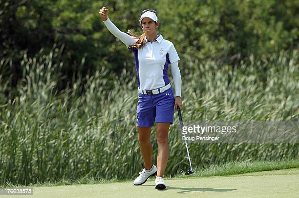 Azahara Munoz of Spain playing for the European Team celebrates as she sinks a putt on the 17th hole to clinch victory with her teammate Karine Icher...