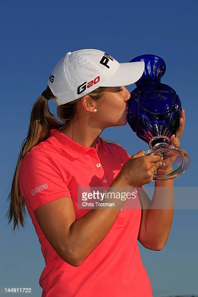 Azahara Munoz of Spain poses with the trophy following her victory over Candie Kung of Taiwan in the championship match at the Sybase Match Play...