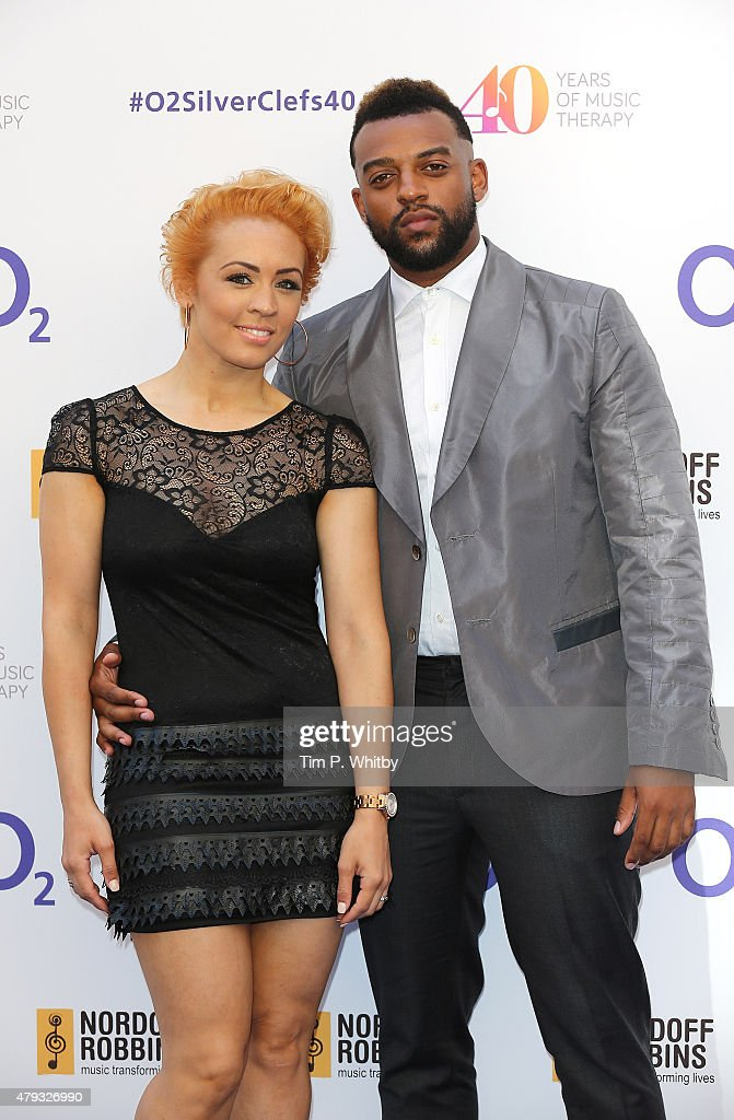 AJ Azari and Oritse Williams attend the Nordoff Robbins 02 Silver clef Awards at The Grosvenor House Hotel on July 3, 2015 in London, England.