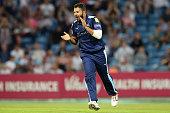 Azeem Rafiq of Yorkshire celebrates dismissing Graeme White of Northampton during the NatWest T20 Blast match between Yorkshire Vikings and...