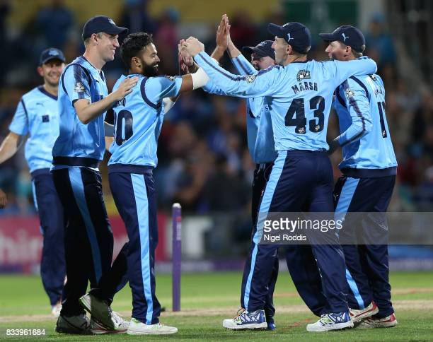 Azeem Rafiq of Yorkshire Vikings celebrates with teamates after taking the wicket of Steven Crook of Northamptonshire Steelbacks during the NatWest...