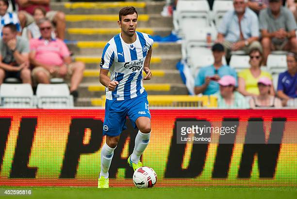 Azer Busuladzic of OB Odense controls the ball during the Danish Superliga match between OB Odense and Hobro IK at TREFOR Park on July 20 2014 in...