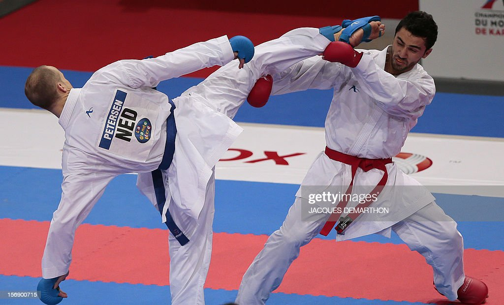 Azerbaidjian's Aykhan Mamayev (R) fights against Netherlands Timothy Petersen (L) during their men's bronze medal bout in the under 84 kg category at the Karate world championships on November 24, 2012 in Paris. Mamayev won the bout.